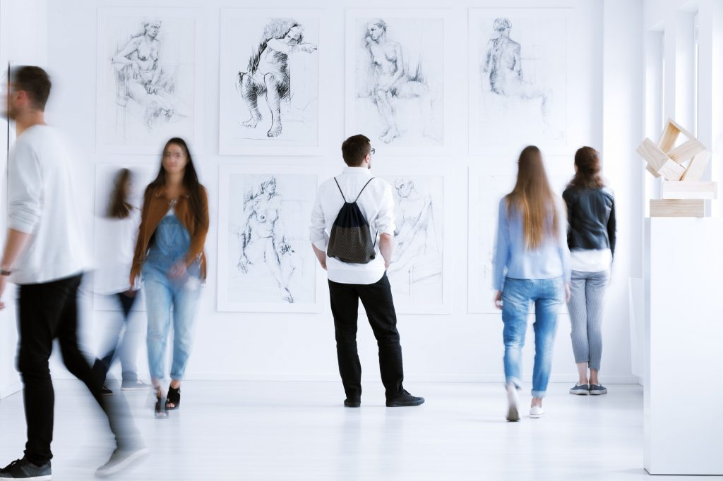 Man with rucksack in gallery